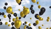 renk : Animation of black and gold shiny balloons floating up in a blue sky with clouds