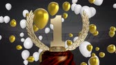 renk : Animation of a gold 1st place trophy with white and gold balloons floating at a sports stadium