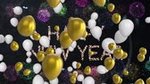 明けましておめでとうございます : Animation of the words Happy New Year in glittering letters with gold and white balloons floating, confetti falling and fireworks on a black background