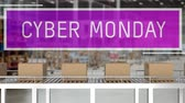 doos : Animation of the words Cyber Monday in white letters on a purple banner with cardboard boxes moving on conveyor belts