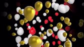 자유 시간 : Animation of red, white and gold balloons floating on a black background