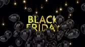 kasım : Animation of the words Black Friday in yellow letters with black balloons and moving lights on a black background Stok Video