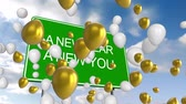 дорожный знак : Animation of the words A New Year A New You on a green road sign, white and gold balloons floating with blue sky and clouds in the background Стоковые видеозаписи