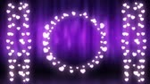 srdce : Animation of a Christmas decoration with a circle and strings of glowing heart shaped fairy lights on a purple background Dostupné videozáznamy