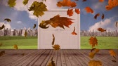 kasım : Animation of colourful leaves falling in autumn with door opening to cityscape in the background Stok Video