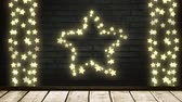 parede : Animation of a Christmas decoration with a star and strings of glowing star shaped fairy lights on a brick wall