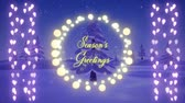 zeichentrick : Animation of the words Seasons Greetings in yellow letters and in a round frame of glowing fairy lights and strings of fairy lights with Christmas trees in the background Stock Footage