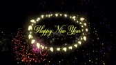 oslava : Animation of the words Happy New Year in yellow letters an oval frame of glowing fairy lights with fireworks on black background Dostupné videozáznamy