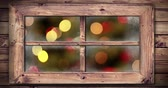 Animation of defocused Christmas lights seen through a window 4k Stock mozgókép