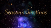Animation of the words Seasons Greetings written in gold letters in front of flickering lights Stock mozgókép