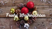 フリッカー : Animation of the words Frohe Weihnachten written in white over Christmas decorations in the background 動画素材