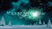 明けましておめでとうございます : Animation of the words Happy New Year in green sparkling letters with fireworks in the background