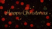 color flicker : Animation of the words Happy Christmas in gold letters with glowing red spots of light in the background