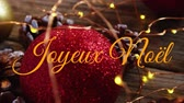 borovice : Animation of the words Joyeux Noᅢᆱl written in orange over Christmas baubles, pine cones and fairy lights in the background Dostupné videozáznamy