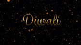フリッカー : Animation of the word DIwali in gold letters with fireworks and glowing spots of light in the background