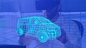 prototype : Animation of 3d technical drawing of a van in blue, with moving grid and a young man in VR headset in the background Stock Footage