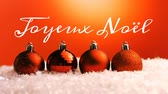kelime : Animation of the words Joyeux Noᅢᆱl written in white with red Christmas baubles in the background