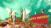 zeepbel : Animation of the words Happy Birthday in yellow letters on red speech bubble with birthday cake and candles being blown out in the background