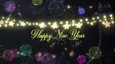 gwiazda : Animation of the words Happy New Year written in yellow letters with a glowing string of star shaped fairy lights and fireworks in the background