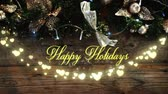 srdce : Animation of the words Happy Holidays written in yellow letters with a glowing string of heart shaped fairy lights and fireworks with Christmas decorations in the background Dostupné videozáznamy