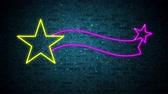 gwiazda : Animation of a flickering Christmas shooting star neon sign in yellow and purple on brick wall Wideo