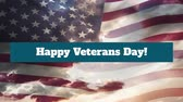 kasım : Animation of the words Happy Veterans Day! in white letters on blue banner with blowing American flag and clouds in the background