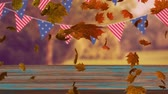 kasım : Animation of colourful leaves falling in autumn in a forest with bunting of American flags