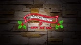 明けましておめでとうございます : Animation of flickering words Happy Christmas & Happy New Year neon sign in red and white with holly and berries on wall 動画素材