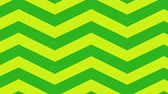 papai noel : Animation of moving green and yellow zig zag Christmas pattern Vídeos