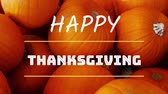 kasım : Animation of the words Happy Thanksgiving written in white letters with a stack of pumpkins in the background