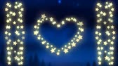 gwiazda : Animation of a Christmas decoration with a heart and strings of glowing star shaped fairy lights on a blue background
