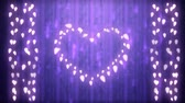 srdce : Animation of a Christmas decoration with a heart and strings of glowing leaf shaped fairy lights on a purple background