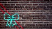 probówki : Animation of a flickering ribbon and bow present decoration neon sign in red and blue on brick wall