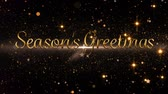 cintilar : Animation of the words Seasons Greetings in gold letters with glowing spots of light in the background