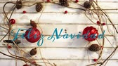 csecsebecse : Animation of the words Feliz Navidad written in blue over Christmas decorations with red baubles and pine cones