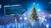 falling stars : Animation of blue wooden arrow sign board with snowflakes and stars falling, with Christmas tree and fir trees on blue background