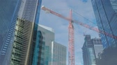 idéias : Animation of cityscape with moving crane, modern buildings and sky with clouds in the background Vídeos