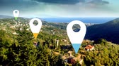 elhelyezkedés : Animation of location pins filling up with blue, yellow and green color over landscape in the background