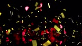 relacionamento : Animation of golden confetti and red hearts falling down on black background