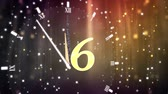 šest : Animation of countdown on New Year Eve, from ten to zero in yellow numbers with ticking clock, fireworks and golden confetti in the background