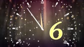 десять : Animation of countdown on New Year Eve, from ten to zero in yellow numbers with ticking clock, fireworks and golden confetti in the background