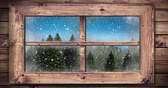 sfeervol : Animation of winter scenery in countryside at Christmas time with snow falling seen through a window 4k Stockvideo