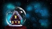 sfeervol : Animation of Christmas snow globe with house inside, snow falling and defocussed blue spots of light in the background