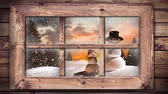 hóember : Animation of winter scenery seen through window with snowflakes falling, two snowmen and fir trees in countryside