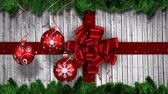 bombki : Animation of snowflakes falling and red ribbon and baubles Christmas decorations and wooden boards on grey background Wideo