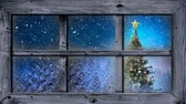 sfeervol : Animation of winter scenery seen through window with snowflakes falling and Christmas tree in countryside