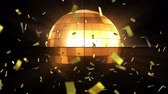 개념 : Animation of spinning glowing disco ball and golden confetti falling on black background 무비클립