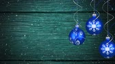 csecsebecse : Animation of snow falling and Christmas decorations with three blue baubles on blue background