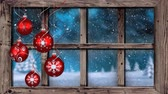 köknar ağacı : Animation of winter scenery seen through window with snowflakes falling in countryside with five red Christmas baubles in the foreground