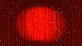 кино : Animation of spotlights on red curtains revealing Christmas glowing lights floating on black background
